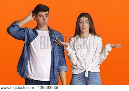 Puzzled Young Couple Do Not Understand What Happening Or Does Something Wrong