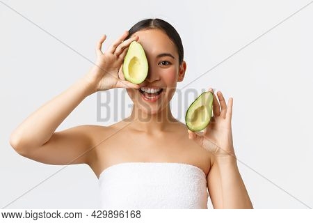 Beauty, Personal Care, Spa And Skincare Concept. Beautiful Happy Asian Woman In Bath Towel Showing A