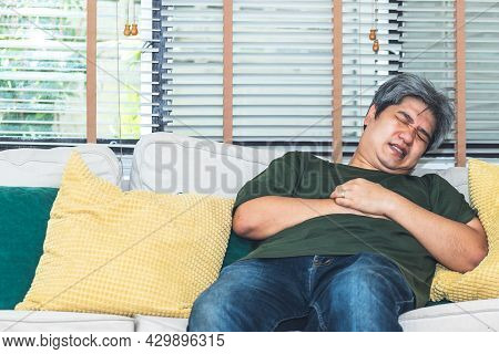 Portrait Images Of Asian Middle-aged Man, Are Suffering From Angina Due To Heart Disease, To Elder A