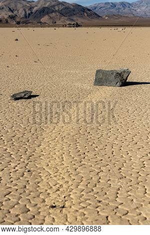 Multiple Sailing Stones Dot The Surface Of The Racetrack Playa In Death Valley National Park