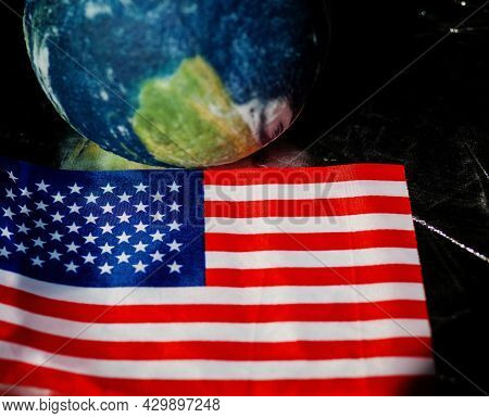 Us Space Exploration Program. Flag Of The United States Of America Near Miniature Earth. Space Explo