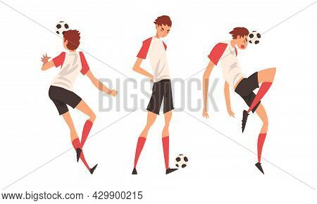 Young Man In Boots And Knee-highs Playing Football Or Soccer Moving The Ball Around Pitch Scoring Go