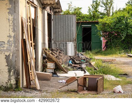 Parma, Italy - May 2021: Outdoor Dumping Of Various Materials, Old Furniture, Sofas And More.