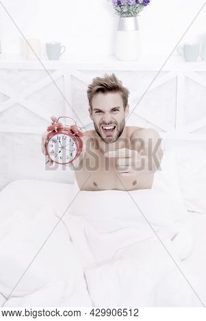 Look At This Clock. Stressful Man Point Finger At Clock Face. Sexy Guy Slept Through Alarm Clock. La
