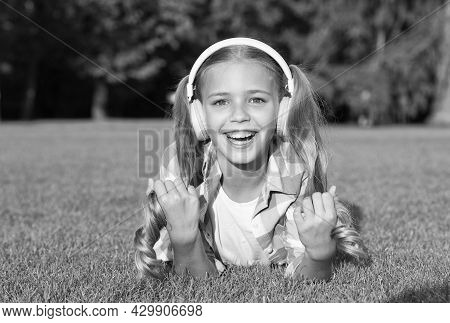 Happy Girl Child With Long Hair Tails Enjoy Listening To Foreign Language School Course In Modern He