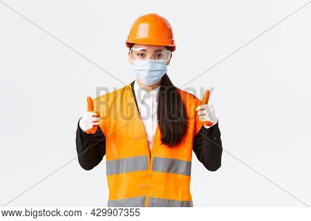Covid-19 Safety Protocol At Enterpise, Construction And Preventing Virus Concept. Confident Female A