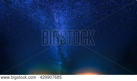 Panorama With Blue Night Starry Sky. Natural Night Sky Background. View Of Glowing Stars Of Milky Wa