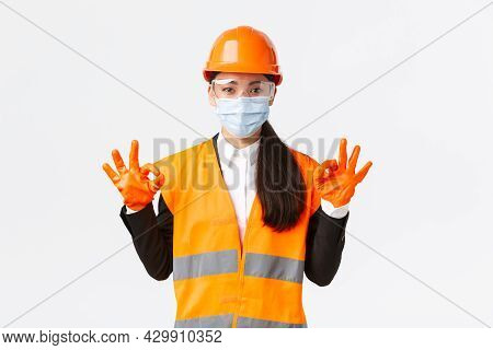Covid-19 Safety Protocol At Enterpise, Construction And Preventing Virus Concept. Satisfied Asian Fe