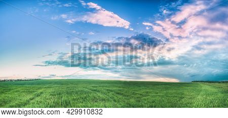 Countryside Rural Field Landscape Under Scenic Spring Blue Cloudy Dramatic Sky With White Fluffy Clo