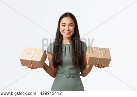 Small Business Owners, Startup And Work From Home Concept. Smiling Asian Female Shop Owner, Packing