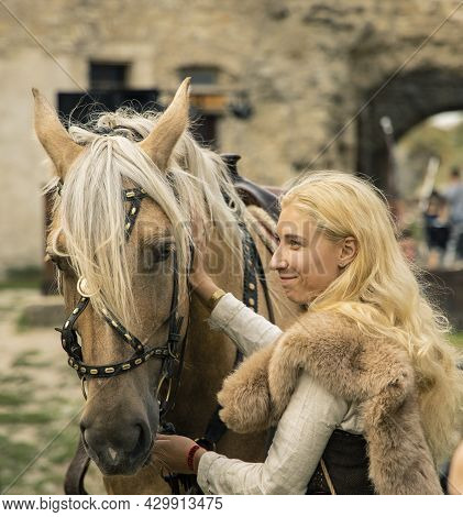 Nordic Caucasian Ethnicity Woman With Her Horse Dramatic Cinematic Photography In Folk Medieval Styl