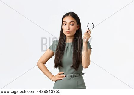 Small Business Owners, Women Entrepreneurs Concept. Asian Female Searching For Something, Holding Ma