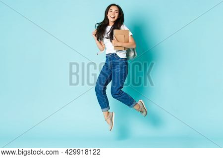 Fashion, Back To School And Lifestyle Concept. Cheerful Young Asian Girl, Korean Student Looking Upb