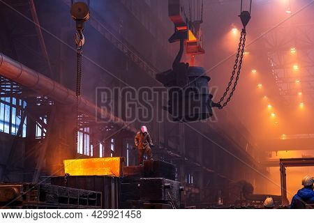 Big Ladle On Crane Before Melting In Foundry Workshop. Smelting Of Multi-ton Cast Iron Parts. Metall