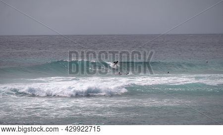 Surfer Riding And Turning With Spray On Blue Ocean Wave, Surfing Ocean Lifestyle, Extreme Sports. Bi