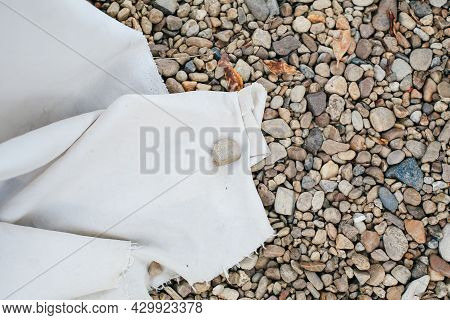 Abstract Background With Round Pebble Stones. Fine Gravel, Natural Stones With White Cloth. Empty Sp
