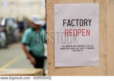 Factory Reopen Sign Inside The Factory Warehouse After Shutting Down Affected By Coronavirus Covid-1