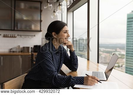 Inspired Indian Woman Sit Near Laptop Daydreams Looks Out Window