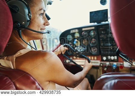Close Up Of Young Brunette Sitting In The Cockpit