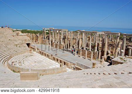 Leptis Magna, Libya - April 2, 2006: Tourists Exploring The Ancient Roman Theatre Overlooking The Me
