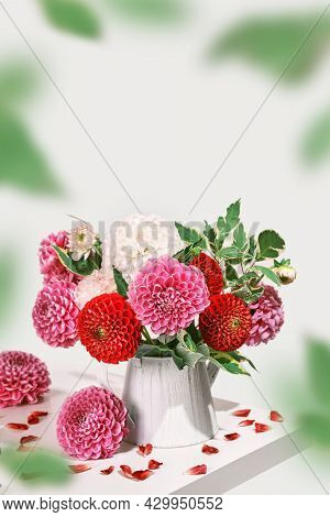 Bouquet Of Beautiful Dahlias Flowers And Petals On White Table. Autumn Festive Decoration, Isometric