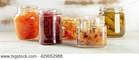 Fermented Food Panorama. Canned Vegetables. Pickles, Sour Cabbage And Other Marinated Preserves In G
