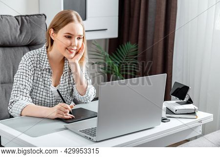 Smiling Happy Woman Designer Using Graphic Tablet And Laptop For Work In Home Office. Freelance Reto