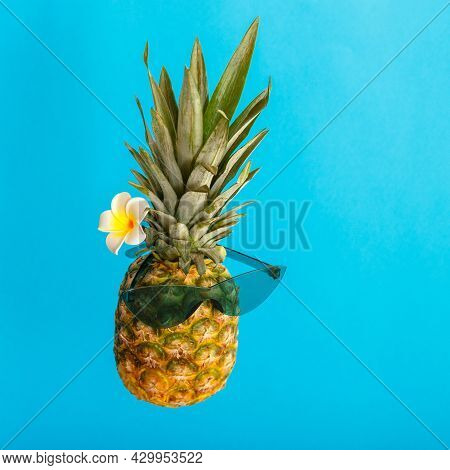 Funny Pineapple Male Face In Green Sunglasses Plumeria Flower. Tropical Summer Fruits Levitating Cre