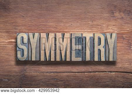 Symmetry Word Combined From Vintage Letterpress On  Varnished Wooden Surface