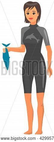 Woman In Wetsuit Holds Fish To Feed Marine Animal In Oceanarium. Trainer, Worker Of Dolphinarium Iso