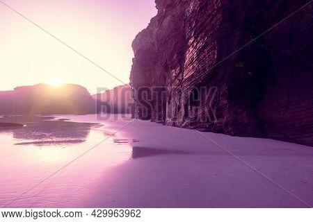 Seascape In The Morning. Rocky Sea Coast At Sunrise. As Catedrais Beach. Beach Playa De Las Catedral