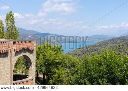 Landscape Of The Grado Reservoir In Huesca Spain With Mountains And A Lot Of Water Near A Christian