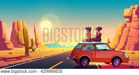 Girlfriends Sit On Car Roof Admire Beautiful Sunset Or Sunrise Picturesque View In Desert With Aspha