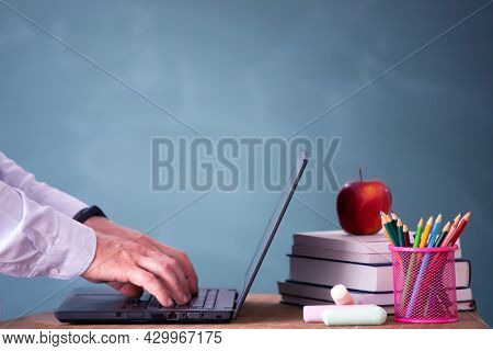 Back to School Concept. School math teacher giving virtual teaching remote class online lesson on laptop computer