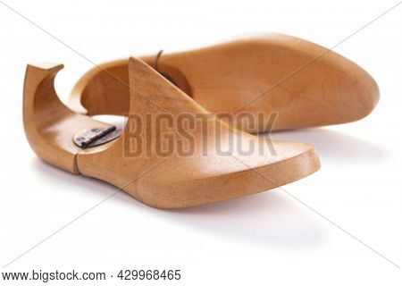 Wooden lasts shoes isolated on white background. Wood last for cobbler