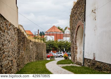 Pelhrimov, Czech Republic, 03 July 2021: Narrow Picturesque Street With Stone Ancient Fortress Walls