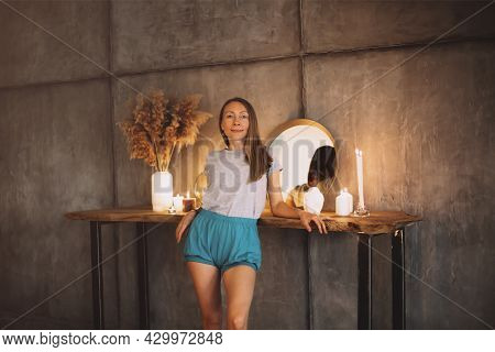 Beautiful Slim Middle-aged Woman In Homewear Leaning On Wooden Dressing Table With Round Mirror, Can