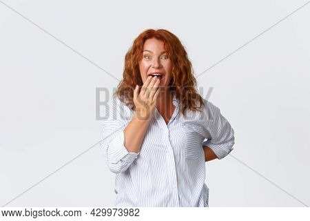 Portrait Of Happy And Amazed Pretty Redhead Middle-aged Woman React To Amusing Event, Laughing And L