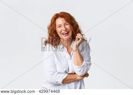 Beauty, Lifestyle And Aging Concept. Portrait Of Attractive Middle-aged Lady Laughing Out Loud, Look
