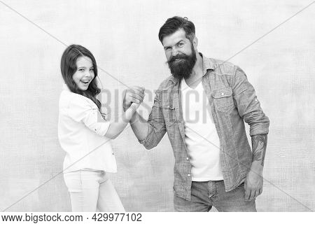 Who Is Stronger. Father And Child Compete In Arm Wrestling. Strength Comparison. Conflict And Opposi