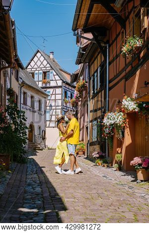 Eguisheim, Alsace, France, Traditional Colorful Halt-timbered Houses In Eguisheim Old Town On Alsace