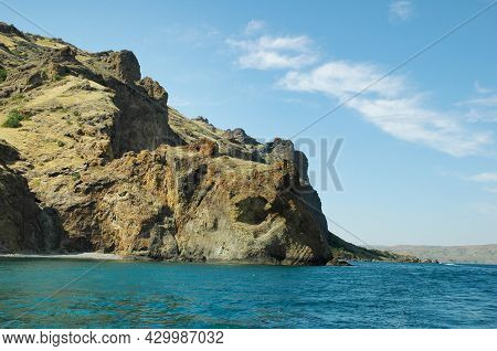 Coastal Cliffs, View From The Sea. Rocks In The Form Of Animals Hang Over The Sea. Crimea. Rocky Coa