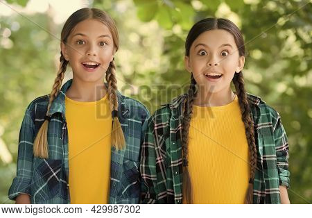 Surprised Little Girls Keep Mouths And Eyes Open With Beauty Look In Casual Fashion Style Summer Out