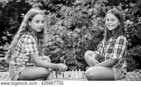 Cognitive Development. Intellectual Game. Make Decision. Smart Children. Little Girls Play Chess. Si