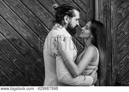 First Meet. Bearded Man Hipster Hug Sexy Woman. Guy Embrace His Girl Outdoor. Couple In Love. Feel T