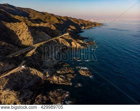 Spanish Rocky Coastline With Camper Car Camping On Cliff Sea Shore. Mediterranean Region Of Villaric
