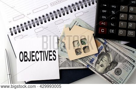 Objectives - The Inscription Of Text On The Sticker On The Planning With Dollars And Calculator