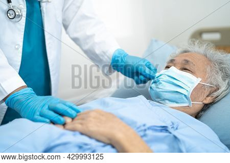 Doctor Help Asian Senior Or Elderly Old Lady Woman Patient Wearing A Face Mask In Hospital For Prote