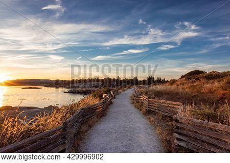 Scenic Path Trail In A Park By The Coastline On The West Pacific Ocean Coast. Summer Sunset. Macaula