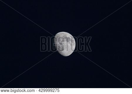 Dark Night Around A Partial Moon With Light And Shadow